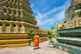 A Monk Walks Past Stupas at Wat Pho (Temple of the Reclining Buddha), Bangkok, Thailand Photographic Print by Jason Langley