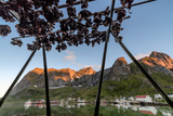 Midnight Sun on Dried Fish Framed by Fishing Village and Peaks, Reine, Nordland County Photographic Print by Roberto Moiola