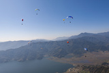 Dozens of Paragliders Enjoy Amazing Views of the Himalayas Above Phewa Lake, Nepal, Asia Photographic Print by Alex Treadway