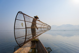 A Basket Fisherman on Inle Lake Prepares to Plunge His Cone Shaped Net, Shan State, Myanmar (Burma) Photographic Print by Alex Treadway