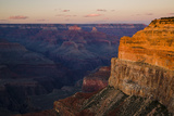 A Low Sun Lights Brahma and Zoroaster Temples and Cliff Below Hopi Point Photographic Print by Garry Ridsdale