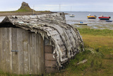 Upturned Weathered Boat Hut with Lindisfarne Castle and Fishing Boats at Low Tide, Holy Island Photographic Print by Eleanor Scriven