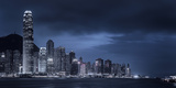 Looking across Victoria Harbour to Skyscrapers on Hong Kong Island with Victoria Peak Beyond Photographic Print by Garry Ridsdale
