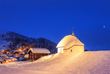 Blue Dusk on the Alpine Village and Church Covered with Snow, Bettmeralp, District of Raron Photographic Print by Roberto Moiola