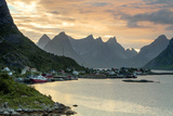 Sunset on the Fishing Village Surrounded by Rocky Peaks and Sea, Reine, Nordland County Photographic Print by Roberto Moiola