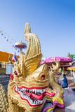 Naga Head Staircase and Devotee at Doi Kham (Wat Phra That Doi Kham) (Temple of Golden Mountain) Photographic Print by Alex Robinson