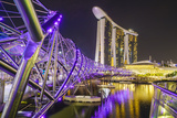 People Strolling on the Helix Bridge Towards the Marina Bay Sands and Artscience Museum at Night Photographic Print by Fraser Hall