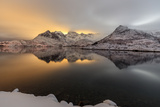 The Light of the Moon and Snowy Peaks Reflected in the Cold Sea Lit the Night at Svolvaer Photographic Print by Roberto Moiola