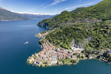 Aerial View of the Picturesque Village of Varenna Surrounded by Lake Como and Gardens Photographic Print by Roberto Moiola