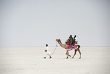 Indian Family Enjoying a Camel Ride in the White Desert Photographic Print by Annie Owen
