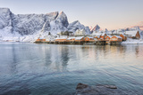 The Colors of Dawn Frame the Fishermen's Houses Surrounded by Snowy Peaks, Sakrisoy, Reine Photographic Print by Roberto Moiola