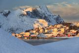The Last Rays of Sun on the Fishing Village and the Snowy Peaks, Kvalvika, Andoya, Reine, Nordland Photographic Print by Roberto Moiola