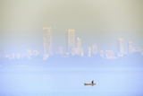 A Fisherman in Front of the Skyscrapers of the Malabar Hills in Mumbai (Bombay), Maharashtra, India Photographic Print by Alex Robinson