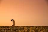 Couple Posing on the Old Wall, Old Walled-In City, Cartagena, Colombia, South America Photographic Print by Laura Grier