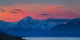 The Last Rays of Setting Sun Strike Peak of Aoraki (Mount Cook) Beyond Shores of Lake Pukaki Photographic Print by Garry Ridsdale