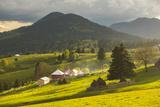 Farm and Haystacks in the Rural Transylvania Landscape at Sunset, Piatra Fantanele, Transylvania Photographic Print by Matthew Williams-Ellis