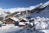 The Village of Obergurgl Sat Below the Huge Peaks of the Otztal Alps and Covered by Winter Snow Photographic Print by Garry Ridsdale