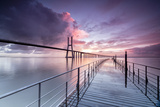 Sunrise Colors the Clouds Reflected in Tagus River and Frame the Vasco Da Gama Bridge in Lisbon Photographic Print by Roberto Moiola