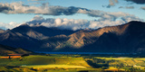 The Plains and Lakes of Otago Region Framed by Cloud Capped Mountains, Otago, South Island Photographic Print by Garry Ridsdale