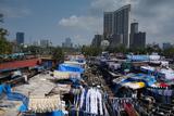 Slum Washing Ghats Surrounded by Expensive Residential Developments, Mumbai (Bombay), Maharashtra Photographic Print by James Strachan