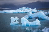 Icebergs Floating in the Glacier Lagoon Beneath Breidamerkurjokull Glacier, Jokulsarlon Photographic Print by Andrew Sproule