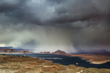 A Storm Obscures Grand Staircase-Escalante National Monument as it Sweeps across Wahweap Bay Photographic Print by Garry Ridsdale