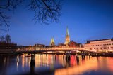 The Lights of Dusk on Typical Bridge and the Cathedral Reflected in River Trave, Lubeck Photographic Print by Roberto Moiola