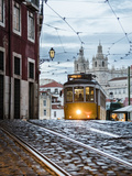 Romantic Atmosphere in Old Streets of Alfama with Castle in Background and Tram Number 28 Photographic Print by Roberto Moiola