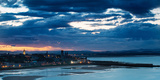 Looking across Bay to St. Andrews Harbour and Pier with Sun Setting Beyond City as Dusk Falls Fotografisk tryk af Garry Ridsdale