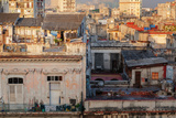 A Man Comes Out of His Rooftop Home in the Early Morning Light in Havana, Cuba, West Indies Photographic Print by Garry Ridsdale