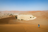 A Woman Runs Down from the Summit of Sossusvlei Sand Dune, Namibia, Africa Photographic Print by Alex Treadway