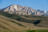 A Distant House in the Grasslands with Views of Mountains in the Distance, Bamiyan Province Photographic Print by Alex Treadway
