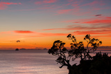 A Dawn Sky Above the Alderman Islands in the South Pacific from New Zealand's Coromandel Peninsula Photographic Print by Garry Ridsdale