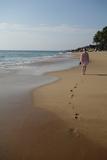 Woman Walking Leaving Footprints on Deserted Beach, Niraamaya, Kovalam, Kerala, India, Asia Photographic Print by James Strachan