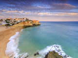 Panoramic View of Carvoeiro Village Surrounded by Sandy Beach and Clear Sea at Sunset Photographic Print by Roberto Moiola