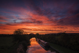 Barges Lay Still on Shropshire Union Canal as Dawn Light Sweeps across Sky Above Beeston Castle Photographic Print by Garry Ridsdale