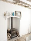 Wood Burning Stove in Cottage Interior, UK Photo by Stuart Cox