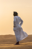 Oman, Wahiba Sands. an Omani Guide Enjoys the Sunset on Sand Dunes in Wahiba Sands. Photographic Print by Nigel Pavitt