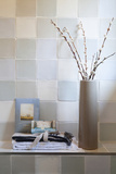 Vase and Folded Towels on Tiled Shelf Photo by Ton Kinsbergen