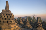 Indonesia, Java, Borobudur. Early Morning Sun Shines on the Dormant Stratovolcano Photographic Print by Nigel Pavitt