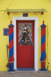 Colourful, Ornate Traditional Doorway and Striped Mooring Posts in the Town of Burano, Venice Photographic Print by Cahir Davitt