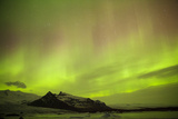 Iceland, Fjallsarlon. the Northern Lights Appearing in the Sky at Fjallsarlonll. Photographic Print by Katie Garrod
