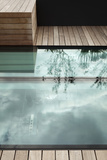 Glass Floor in Decked Roof Surface with Reflection of Plants in Large Planters Photo by Pedro Silmon