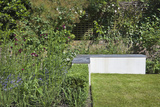 L-Shaped Concrete Bench with Slate Top in Garden, London Photo by Pedro Silmon