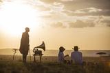 Kenya, Mara North Conservancy. a Couple Enjoy a Sundowner in the Mara Fotografisk tryk af Niels Van Gijn