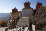 Nepal, Mustang. Chortens and an Ancient Stone Carving En Route Between Samar and Giling. Photographic Print by Katie Garrod