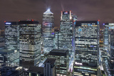 The New London Financial District in the Docklands at Night. Photographic Print by David Bank