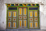 Nepal, Mustang, Lo Manthang. Brightly Painted Doors in the Ancient Capital of Lo Manthang. Photographic Print by Katie Garrod