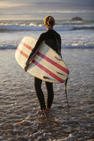 Uk, Cornwall, Polzeath. a Woman Looks Out to See, Preparing for an Evening Surf. Mr Photographic Print by Niels Van Gijn