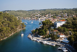 Greece, Paxos. Yachts and Pleasure Boats Moored in the Entrance to Gaios Harbour Photographic Print by John Warburton-lee